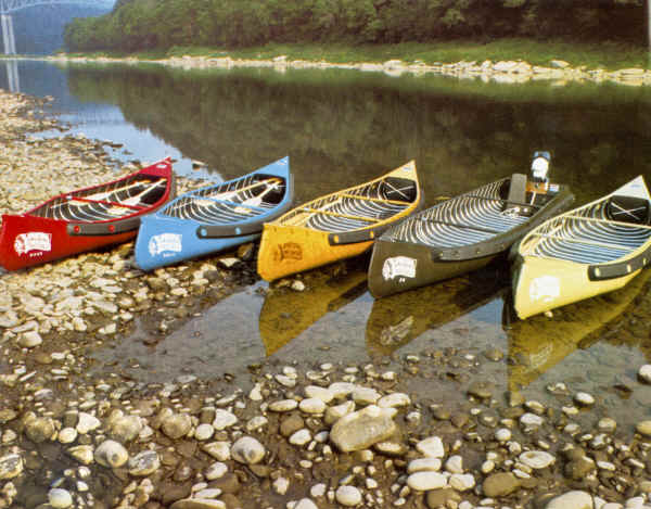 Fleet of Sportspal Canoes on the river