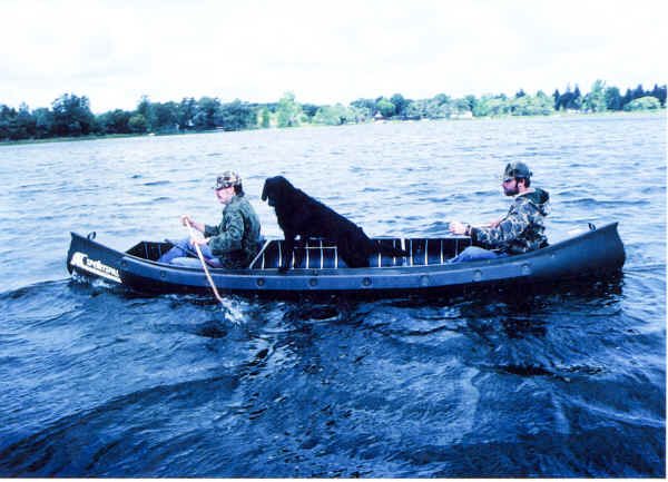 Sportspal Model S-16 Canoe with a hunting dog