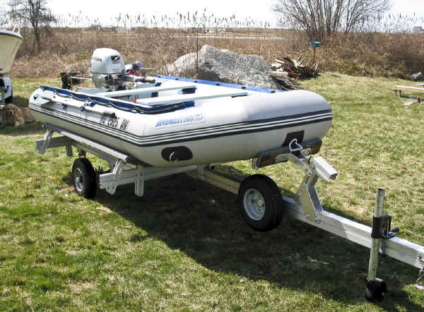 Trailex SUT-450-I Trailer with a Sea Eagle 10.6 Inflatable boat plus a Honda 9,9 Outboard