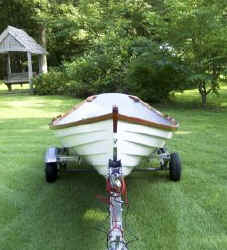 Melon Seed Rowing Skiff on Trailex SUT-500-S Trailer